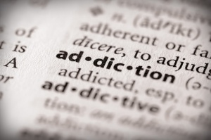 What is the definition of addiction?